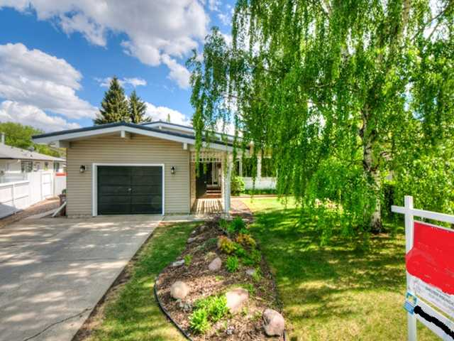 This completely renovated 4 level split in quiet Forest Lawn, St. Albert is sure to impress. All levels are completed with 4 bedrooms + den and an attached garage. The top level provides 2 bedrooms with a crisp white and soft blue renovated bathroom. The main level features vaulted ceilings, maple hardwood flooring with slate flooring entrance and a large gas burning fireplace. The kitchen has been completely renovated with quality finishing's and is open to the dining area and living room. The third & fourth level are completed and provide a family rm, 3 bedrms, a 3 pce bathroom and a laundry & storage area. Upgrades include: Custom Superior Kitchen with Granite counters and backsplash 20k, Charcoal forever metal roof, Custom Trex Deck w/ clear glass railing 10k, Scandinavian Custom Bathroom 15k, Beautiful Maple floors (cafe au lait) 20k, new windows & Doors 10k. The large private backyard is nicely landscaped with a 2 tiered deck and is a perfect place for summer BBQ with family and friends.