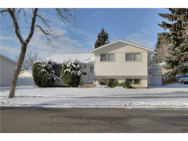Mcleod split level on a mature street, There are many original owners within this great community! Vinyl siding on the front, stucco on the remaining sides. A long drive way leads to the large double garage perfect for keeping snow off your vehicle! The yard is fully fenced and features many fruit trees. Inside is inviting with rounded corners, and a large upgraded oak kitchen featuring newer window with dual push outs. Eat in your open dining room with a newer faux glass block window. Real hardwood throughout the main gives you a touch of class to the d?cor. Upper floor has 3 bedrooms, 1 full bath plus a 2 piece ensuite, rare for this vintage! Basement has some newer/upgraded development in the family room area. Newer furnace (high efficiency) and hot water tank (standard efficiency). Come see it, you'll love this place!