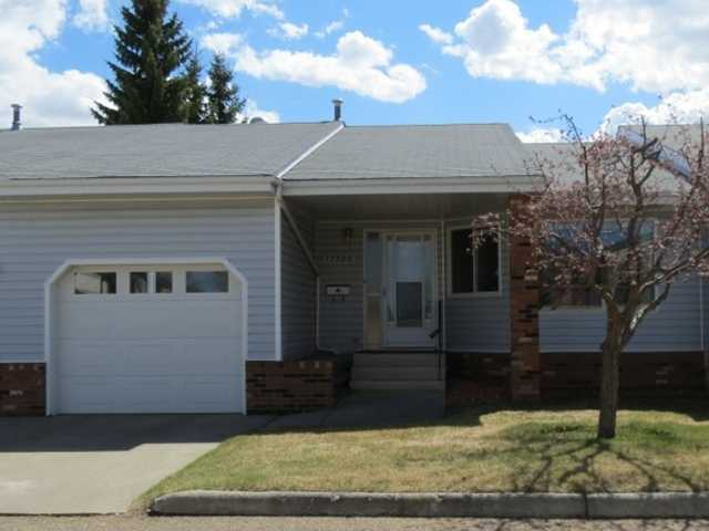 Located in a 50+ community in Callingwood, this 1033 sq ft bungalow welcomes you. This unit features an open concept kitchen with dinette/formal dining/living room design with abundant natural light. Patio door open to an inviting 9X13 enclosed deck. Completing the main floor are 2 bedrooms, a 4 piece bath and a laundry room. Carpet, lino and laminate throughout. The basement is largely unfinished for you to develop as you wish. New windows and patio doors are to be installed for new owner. Single attached garage. Great recreational facility in community. Close to shopping and all amenities.