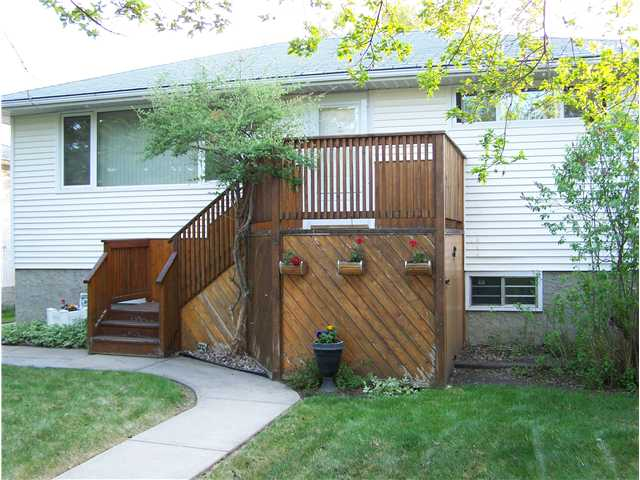 Stunning Bungalow with Fully Finished Basement and Large Bright Windows on quiet street. Very close to bus to Downtown & Kingsway. Walking distance to Elementary schools...Children will LOVE the NEW Community PLAYGROUND coming this Summer 2014. Enjoy the peaceful, quiet, private Fully Fenced Yard - Newer Cedar Fencing with mature trees and Saskatoon Bush. Large Cedar Deck leading to an awesome Firepit and brick patio to enjoy & roast your Marshmallows for Smores!! There is an oversized Parking pad just off the paved lane leading to garage. Enjoy the large Eat-in Kitchen with bright Upgraded cabinets & plenty of Corian Counters. Newer windows in home including NEW windows in Living Room & Master Bedroom a couple years ago. Spacious home with plenty of upgrades such as Jacuzzi Tub in Main Floor bathroom, Arched doorways, & Rounded corners in Living Room. Upgraded 100 AMP Service & New Hot Water Tank. Included in sale is Window Air Conditioner in Solarium, Water Softener, & Reverse Osmosis Water System.