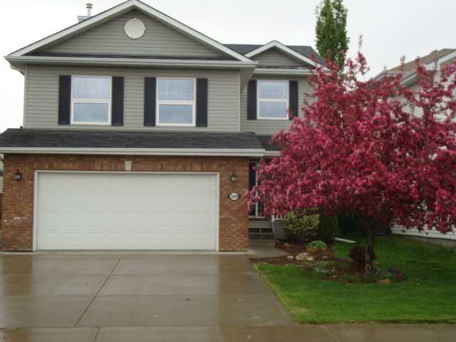Welcome Home to Breckenridge Greens!! This fully finished two storey offers you and your family everything you need. Main floor has open kitchen concept with a large Island that's great for entertaining, living room and hardwood throughout. Step out to your patio from the dining area and enjoy the large west facing landscaped yard backing onto the Lewis Estates golf course! Upstairs you will find a bonus room with vaulted ceilings and a fireplace accompanied by custom built shelving. Two generous bedrooms and of course the master bedroom that overlooks the beautiful golf course with its own en suite. And of course on those hot days stay comfortable with the central air conditioning. Downstairs is finished with a family room and great storage area. (bathroom just needs to be completed) This home is waiting for you!! Welcome Home!!