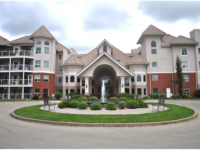 The River Grande is located downtown Edmonton in the Brickyard across from the river valley and is a desirable 18+ upscale condo. Surrounded with river valley walking/ bike trails at the front gate. This pet friendly building allows small dogs and cats and has great amenities including recreation room with pool table, shuffleboard and tv area. There is a social room, exercise room, library, car wash and more. This upgraded 3rd floor unit features an open plan with island kitchen, eating area, large living room with gas fireplace, two spacious bedrooms, two full baths, a large laundry room with storage space. Master bedroom has full ensuite and his and her closet.There is a large balcony with access from both the master bedroom and living room. There is also a self contained storage room off balcony with central air conditioning unit and room for large items. All utilities included in condo fee except electricity. Parking stall unit and storage cage #103. The current reserve fund is over-funded!