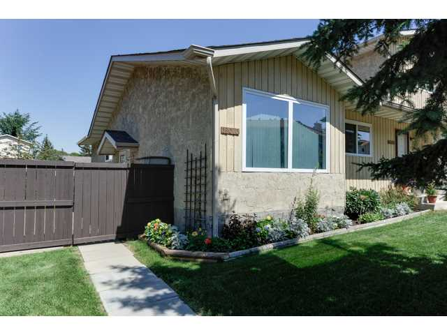 RARE OPPORTUNITY. This clean and lovingly maintained 1055 sq ft Bungalow 1/2 duplex Condo is fully finished. Located on a quiet street.. Ideal with tons of street parking. Southern front exposure. Side entrance thru the fully fenced yard. Ground level deck and well manicured lawn (raspberry bushes). Double Parking Stall right out the back. Entry has Beautiful Glass Pendant lighting (my favorite) Main floor features neutral paint, brand new carpeting in the spacious front living room and dining room. All new windows. Just like new Thomasville Maple cupboards with under-counter lighting, glass backsplash and full wall pantry. (soft close drawers). Three bedrooms upstairs. Master is a great size. Basement is fully finished. Bright & open rumpus room with recessed lighting. 1/2 bathroom. Laundry area and storage area lead to den with potential for 4th bedroom. Condo fees are $255 per month & include reserve fund contributions, exterior maintenance, lawn and snow removal. All appliances. show a 10.