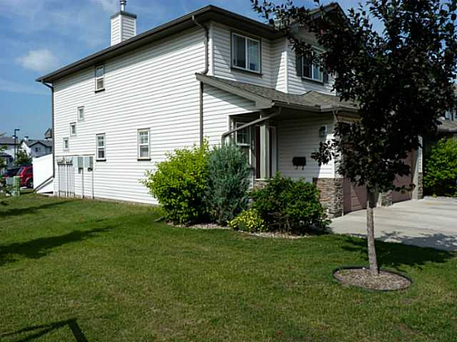 This 2 bed 2.5 bath townhouse is an EXCEPTIONAL VALUE! The small details are what sets this unit apart and above the others. Little things like the lighted stairway show this is not your average unit. An open plan on the main floor is very inviting and ideal for hosting friends or family. The two large bedrooms each have their own full 4 piece bathrooms plus there is a 2 piece powder room on the main floor. Being an end unit at the end of the complex also means you have ample visitor parking on the street which complements the single attached garage and double wide driveway. Located across the street from Mill Creek Ravine means you have access to miles and miles of trail system. The new state-of-the-art Meadows Rec Centre is mere minutes away and scheduled to open Fall/Winter of 2014. A wide selection of shopping and amenities are conveniently located nearby.
