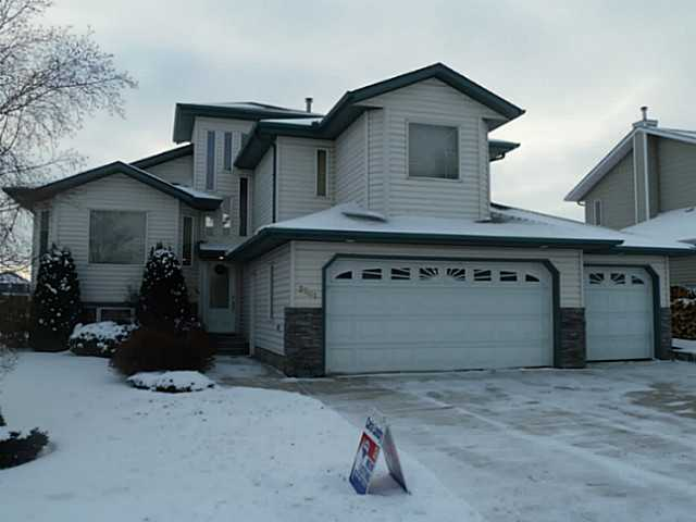 Picture perfect elegant bright and clean bi-level situated in a superior location backing onto green space and pond has plenty of bells and whistles. The open and spacious great room floor plan features an entryway with towering windows above, vaulted ceilings, gourmet island kitchen with walk-in pantry, 3 sided gas fireplace, main floor laundry and a flex room that can either be used for a dining room or a den/home office etc. The master suite has plenty of closet space and boasts an ensuite with an air massage jet tub and separate shower. The basement is professionally finished with a large rec room/games area, another gas fireplace, 2 bedrooms and a 3rd full bathroom. Utility room has direct access to triple attached insulated and triple drywalled garage with hot and cold water taps. Low E windows throughout, custom Hunter Douglas blinds, 2 tiered south facing deck and large garden shed to match the house. A splendid property that offers a quick possession!
