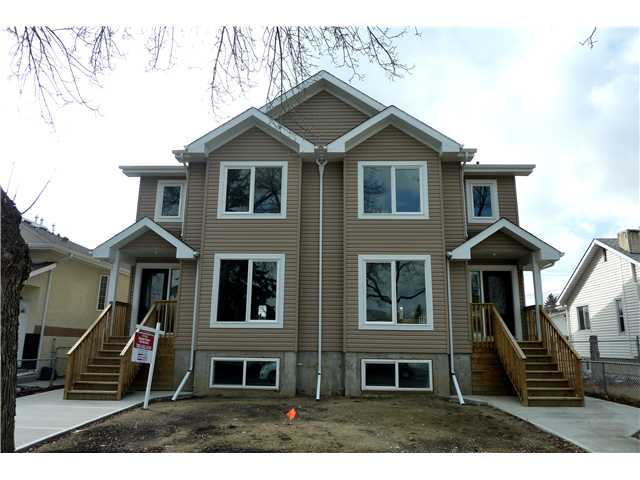 """** Note This Unit e Finsihed Identical to 12224 - 88 St.(Save Cabinetry,Granite Island/Counters/Vanity, Ceramic Tile Lower Level.)New Construction.European Craftsman Duplex.Totally Finished.Massive 1965 sq.ft.3 Brdrm Up 1 Main.2 Additional Bdrms./Separate Self Contained Basement. Bdrm 2 Full Kitchens 4 Full Baths Total.Bright Open Plan.Kitchen c/w Island/Loads of Cabinets/Pantry.Attention to Detail Throughout.Hardwood on Main and Second Floor.Ceramic Tile/Wood Metal Railing,Sliding Door off Kt. to West Yard.Giant Master Suite c/w Walk in Wardrobe.2nd Floor Laundry Room.Bright Lower Level w/Separate Entrance Features 2nd Kitchen/Living Space/2 Bedrooms. Quaility 14mm. Laminate. 9'Ceilings Main/Bsmt.Double Garage, Fenced Yard,Poured Sidewalks. Recently Completed Infrastructure Roads/Sidewalks.Schools,Trans.Steps Away.Many In-Fill Properties nearby.Revenue Winner/Extended Family.""""GST Inclusive in Price"""" $ 459,900 Short Commute to Downtown/Nait/Yellowhead.12224-88 St"""