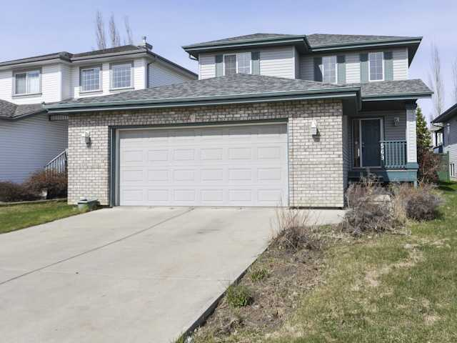 This 1709 sq. ft. 2 storey home is situated on a quiet street in Haddow. The open concept main level has a spacious and bright kitchen boasting plenty of cabinetry, a large island with eating bar and dining room with patio door access to the deck. The living room has large windows, a tile surround corner gas fireplace and hardwood flooring throughout. The upper level has three sizeable bedrooms including the master bedroom with 4-piece ensuite. The fully finished basement offers a family room, 3-piece bath and two additional bedrooms. Additional features include a double attached garage, a fenced backyard with fire pit and is close to schools. Original owner home, needs some TLC.