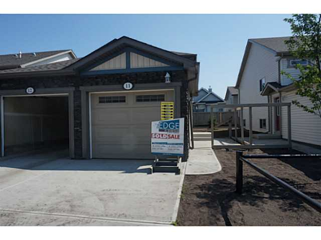 """Condo living in this lower unit with 9.5"""" ceilings. Enjoy 1034 sf of living space with this open concept kitchen/ eating area, living room, 2 bedrooms, 4 piece bathroom and mechanical room with laundry space. Front attached single garage & landscaped yard."""