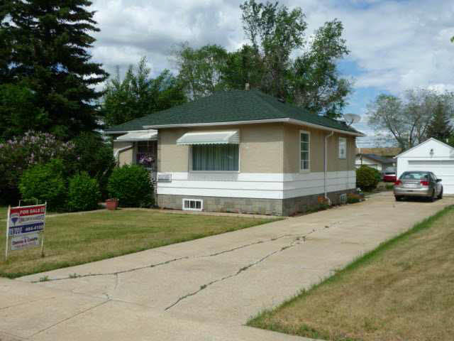 Enjoy the calm and peaceful small town living in this affordable property located in the Village of Holden approximately 1 hr east of Edmonton on Hwy 14. This cozy 872 sq.ft. bungalow was built in 1951; boasts a very bright and open kitchen/dining area, spacious living room, 3 pce bath, main floor laundry room located off rear entry and plenty of storage space throughout. The partially finished basement includes 2 extra bedrooms, separated by a den; and a utility room with plenty of storage. Single detached garage and plenty of extra parking available on the adjoining concrete pad. Situated on a large 75x140 landscaped lot that is partially fenced containing trees, shrubs and large garden area. Lots of potential here to expand on making this property a great starter home or investment property.