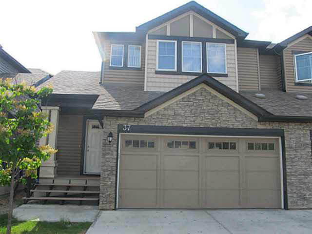 Double GARAGE duplex is a perfect home in the heart of Terwillegar. House include 3 bedrooms plus loft, 2? baths, family room, gas fireplace, oversized insulated double attached garage, front veranda, rear deck, fully landscaped front and backyard. Open concept main floor offers; ? bath, spacious kitchen with stainless steel appliances and upgraded cabinetry, nook / dining and living room with a fireplace adding warm & cozy feeling. Bright stairs takes you to the loft on the second floor which can be used as sitting or computer / reading room. The second floor also features large Master bedroom with en-suite, two descent size bedrooms and a full washroom. The unfinished basement includes laundry area with washer & dryer, rough-in for future washroom and awaits your creative ideas for future flex room & storage space. Walking distance to Public and Catholic Schools, Terwillegar Rec center, Public transit, with easy access to Anthony Henday and Whitemud.