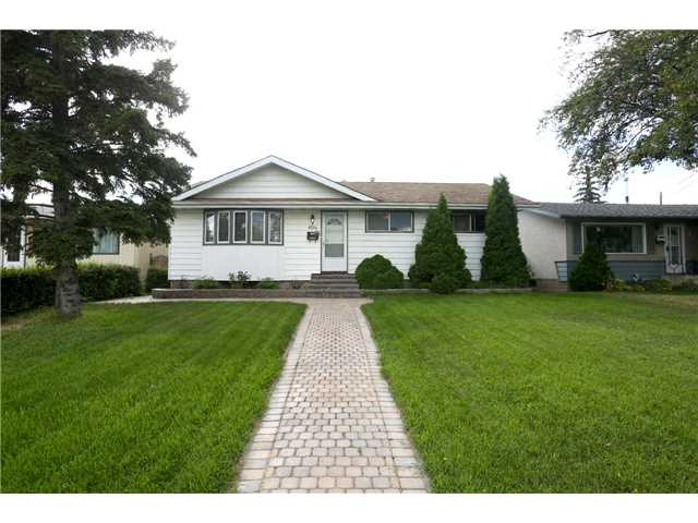 This 1367sqft bungalow is situated on a quiet street in Elmwood. This home has a very open design concept with a spacious kitchen complete with brand new counter tops and a large walk in closet . Also on the main floor are 3 bedrooms, a living room and huge cozy family room with wood burning fireplace. Also completing the main floor is a den/hobby room. Recent upgrades include new vinyl flooring in the kitchen, living & family rooms and new carpets in the bedrooms. Central Air Conditioning. This home offers an oversized 26'x24' detached garage and room for rv parking plus a very spacious yard. The basement is partially finished to drywall stage. This home is perfectly located within walking distance to bus stops, schools, shopping including West Edmonton Mall & Misericordia hospital.