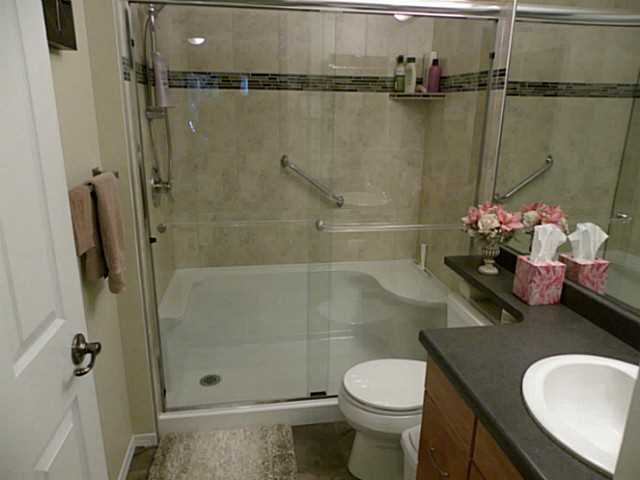 SPLASH renovated this bathroom as there were two full deep tubs. Now there is a 5 ft shower with heavy glass doors, seat and top end fixtures.