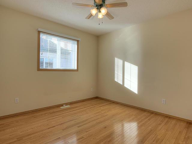 This 3rd bedroom has a large window, walk in closet and laminate flooring.