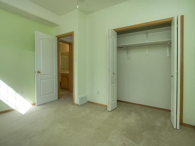 The 4th bedroom has carpeting and a regular style large closet. There is a ledge also in this room.