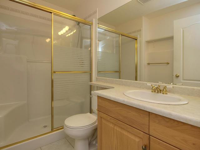 The basement bathroom has a nice double shower with a seat and another banjo top vanity.