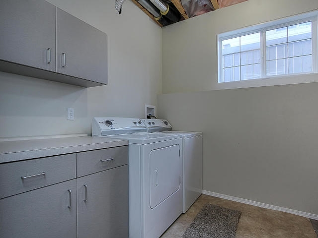 One of the two separate laundry rooms is in the utility/furnace room. The cabinets are very handy for storage and the light is natural from yet another large window