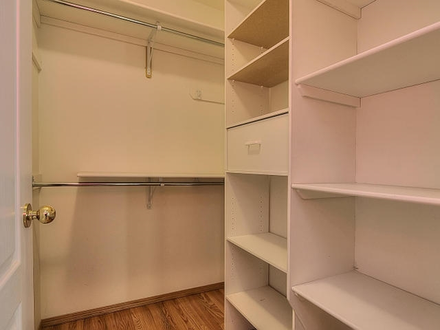 The walk in closet in the master bedroom is very handy and well organized.