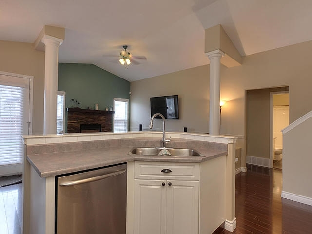 This bright white kitchen has so many lovely features and lots of practical ones also. Utilize the corner pantry, enjoy the stainless appliances and the glass front cabinets for special items you want to show off.
