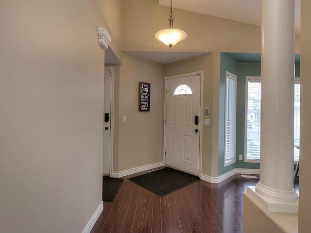 The details inside are consistent, there are three areas with columns and the laminate flooring is throughout.