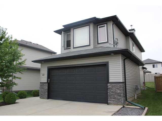 THE SELLER IS OFFERING A $ 5000.00 CASH INCENTIVE!Welcome to Legacy Park, an immaculate 2 storey in family neighborhood.This 1775 sqft 3 bdrm home sits on a professionally manicured lot. Amazing Curb Appeal In show home condition, it boasts a functional & spacious main living plan-rich tones, natural light, upgraded flooring & ceramic tile feature fireplace. The kitchen features a large center island -raised eating bar, corner pantry and granite throughout. A garden door leads to the W facing backyard oasis with custom privacy screens, enclosed gazebo and stone patio. A 2 pc bath is perfectly tucked away & laundry/mudroom complete the space. The upper level bonus room has wall to wall windows, vaulted ceiling and an HD projector and screen. All 3 bedrooms are well appointed and generously sized, the 4pc bath has jacuzzi tub.. The Master is KING sized with a walk in closet & glass enclosed dbl shower ensuite. Garage is oversized (think full sized truck), insulated and drywalled. Great Value! Move in Ready!