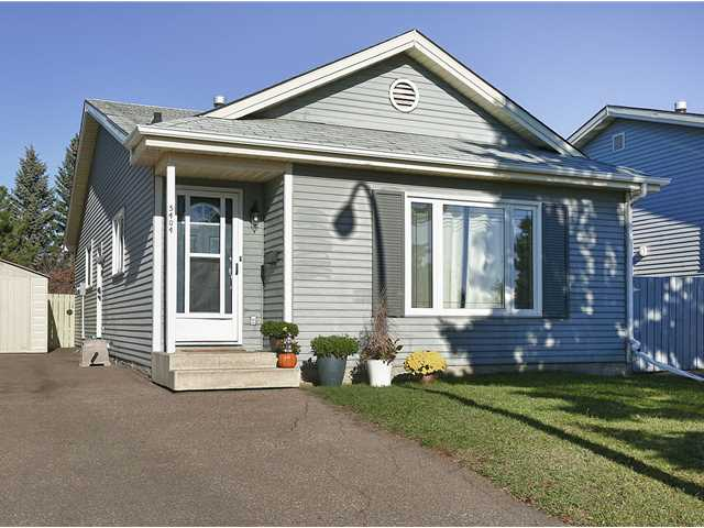 Everything's been done for you! MOVE RIGHT IN to this beautifully decorated contemporary home. This fully finished 3 bdrm, 2 bath BUNGALOW is perfect... and it BACKS ONTO A PARK! Spacious main floor features laminate flooring & new paint throughout open-concept kitchen / living / dining space. Kitchen boasts new lower cabinetry, new counter-tops & painted upper cabinets. Huge master suite with WALK-IN CLOSET + cheater door to 4 pc main bath. 2nd & 3rd bdrms have closet organizers - perfect for the growing family! The basement has been professionally finished with rec room (w/ electric fireplace + WET BAR w/ tile floors & GRANITE COUNTER-TOPS!), full bath (w/ in-floor heating!), 2 dens (one of the dens could be a 4th bdrm if window was made larger), and large laundry/storage room. NEW WINDOWS throughout. NEW ASPHALT DRIVEWAY ('98). NEW SHUTTERS. Enjoy your privacy in the large, fully-fenced, fully-landscaped yard which backs onto a park. Close to all amenities w/ quick access to Anthony Henday.