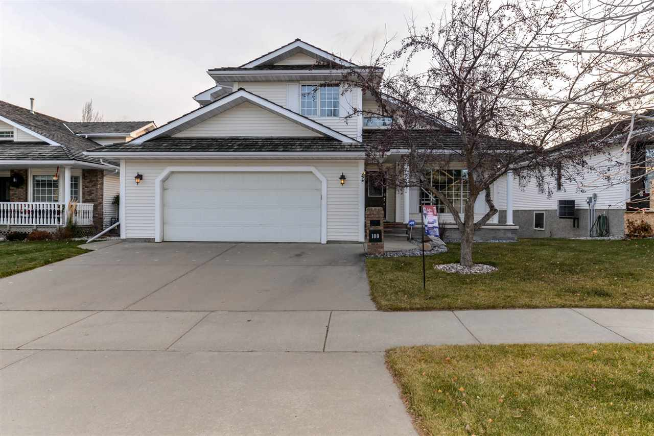 Former show home backs onto park & lake.  2050 sqft 2 storey with fully developed walk-out bsmt - 2 fireplaces - hardwood flrs throughout main floor - Formal dinning room - Island kitchen - Extra B. R. & Rec Room + 3 piece bath down.