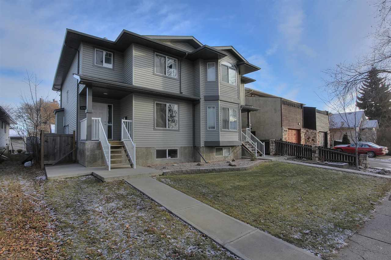 Almost Brand New! Wonderfully maintained 1650 sq Ft newer half duplex. 3 bedroom, 3 bathrooms and a DOUBLE DETACHED GARAGE! The perfect floor plan with a private SIDE ENTRANCE and an untouched basement with roughed in plumbing for a bathroom and a SECOND KITCHEN. Enter through the front door into your generous foyer with huge closet onto beautiful bright laminate flooring.  FANTASTIC LOCATION close to everything, DOWNTOWN, shopping, schools and more! The HUGE GREAT ROOM style living, dining and kitchen space will impress.  Plenty of room for a large media setup, oversized dining area and a large ISLAND KITCHEN with pantry and a 2 piece bathroom.  MAIN FLOOR LAUNDRY will make your life easier.  Functional boot room style rear entry with seat leads out to your deck overlooking your fenced in yard and double garage with back lane access.  Upstairs to your 3 ample bedrooms including a lavish MASTER SUITE with walk-in closet and 3 piece en-suite and a second 4 piece main bath!