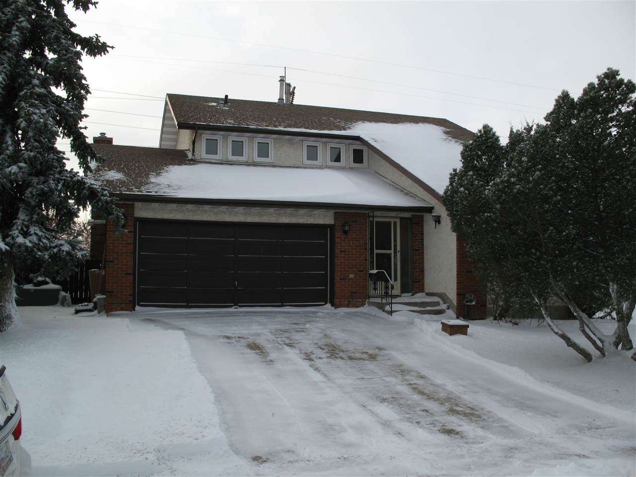 UPGRADED One of a kind character home BACKING ONTO GREENSPACE! New gourmet kitchen with GRANITE countertops and top of the line stainless steel appliances. The kitchen overlooks the formal dining room, breakfast nook and family room with stone gas fireplace. Patio doors lead you to the deck and PRIVATE LARGE south facing fenced yard. Upstairs features 3 bedrooms, laundry room, and a master suite with HEATED FLOORS and travertine tile  Jacuzzi tub. FULLY FINISHED BASEMENT with den, rec room and full bath with HEATED FLOORS. New flooring throughout, newer shingles, high efficiency furnace, newer hot water tank, and HEATED double attached garage.This home is a must see!