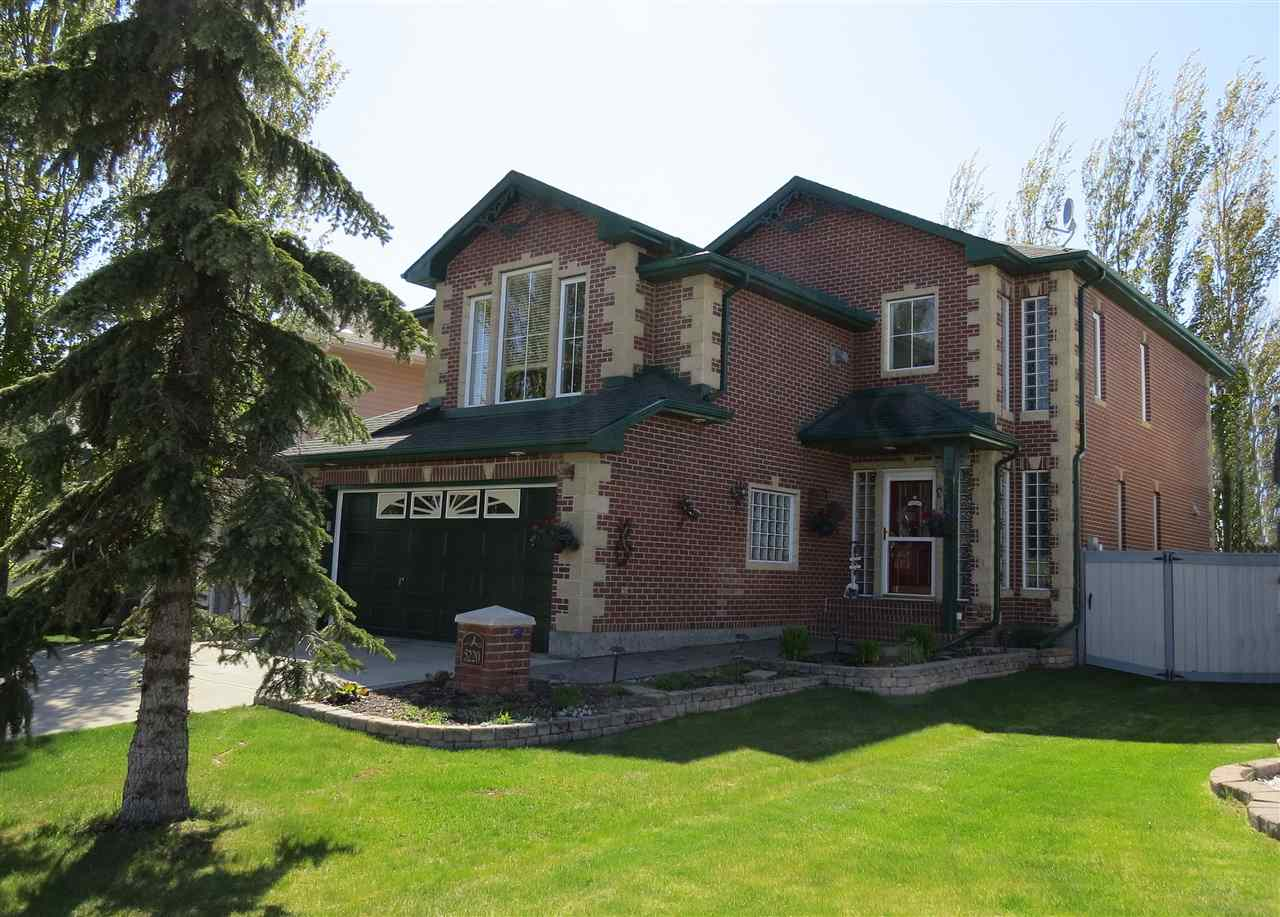 A beautiful 3 bedroom 2100 sqft.  two storey home, with a classy brick exterior finish and an extensive list of recent upgrades. Located in Jamieson Place, in a quiet location.  The flooring throughout the home, is impressive hard word, part of the recent upgrades. Other updates include: shingles, fencing, a new deck, paving stones, water heater and appliances, etc.  The bonus room, a perfect place for the family or to relax, comes with a brick faced gas fireplace. The master bed room is spacious with a walk-in closet and has a new ensuite with a soaker tub and multi-head in a humongous shower.  There is the luxury of central air conditioning and an electronic air cleaner. The large west facing deck is a raised, secluded by trees, backs on to an open space, comes with a gas BBQ outlet, the perfect place to entertain or enjoy the warm summer afternoons and evenings. The front entrance and side yards are beautiful landscaped with paving stones. Elementary schools are within walking distance.