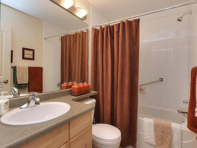 The main bathroom has a deep soaker tub, extra wide cabinet and banjo counter top. There is also a medicine cabinet.