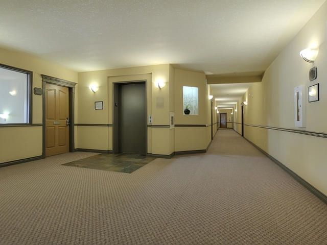 The elevator is just steps away from suite #223.