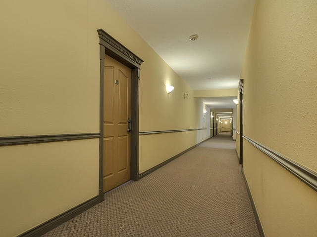 The hallways in the A building and your front door are well cared for. Unit 223 is just steps away from the elevator and also the social room and library. The guest suite is also on the second floor.