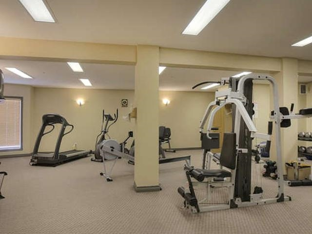 The larger of the two fitness rooms are on the main floor very close to the elevator so very close to your unit.