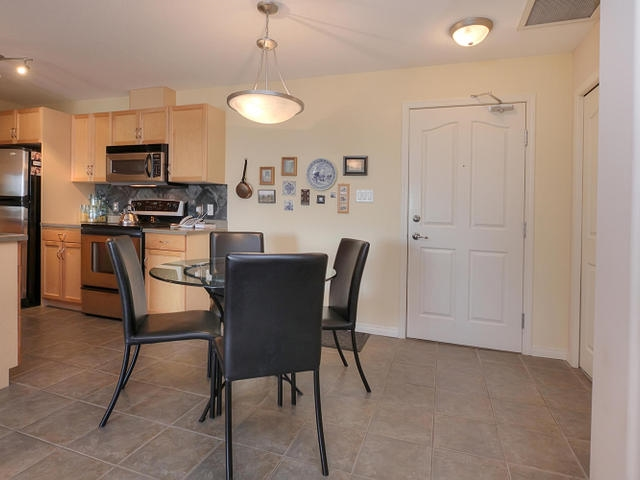 The dining area is located beside the kitchen and has the same ceramic tile flooring for convenience and easy maintenance.