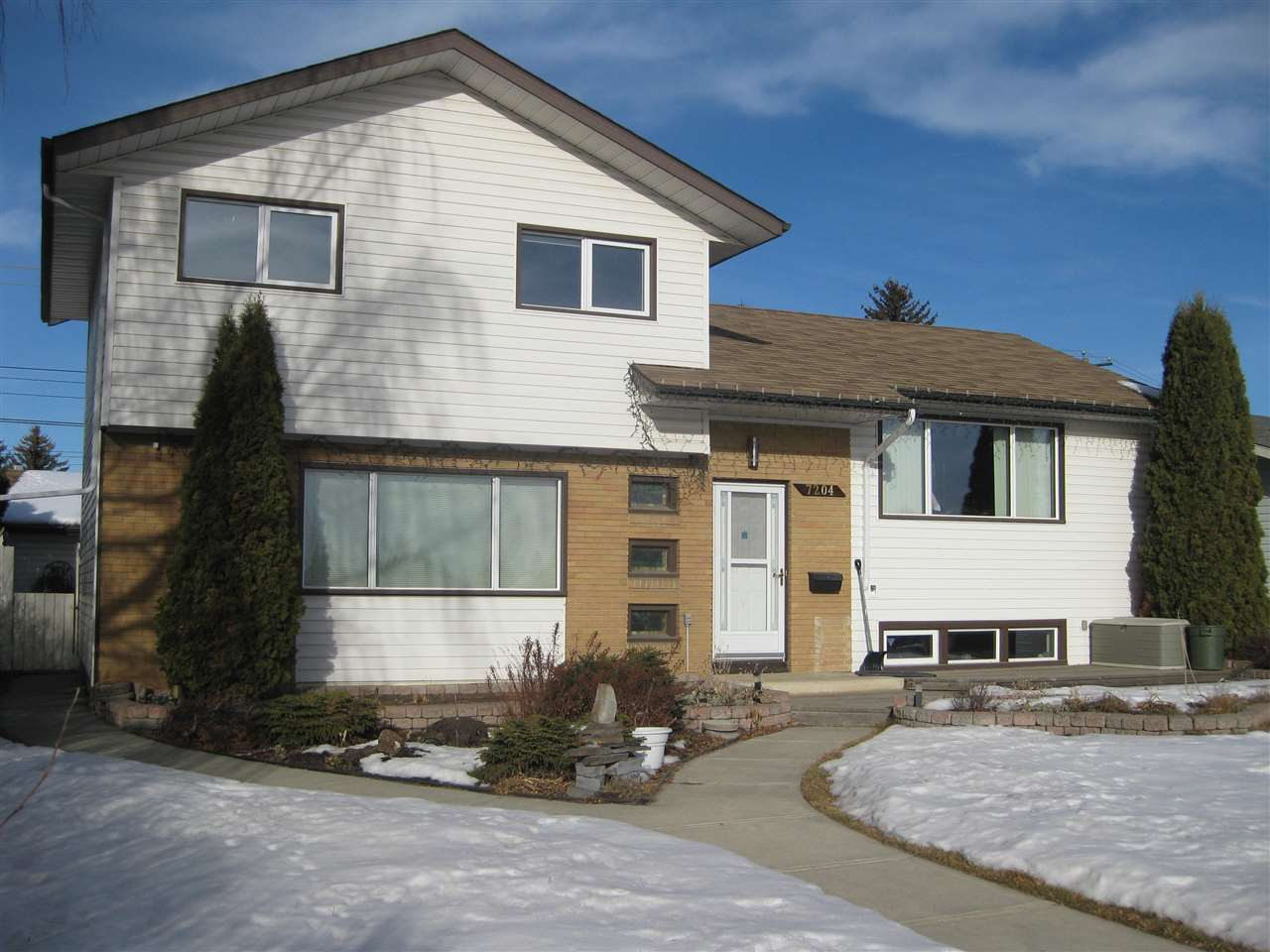Fantastic family home in desirable Ottewell!  This Golden Homes built 4 level split has 4 generous sized bedrooms, fully finished 3rd and fourth levels with a total of over 2000 sq ft of living space.  This home has been upgraded from original including a gorgeous Maple kitchen with cupboards, pantry and desk area spanning the bright space, open to dining area.  This home has a spacious  living room, overlooking your front deck and beautifully landscaped yard, across from Clara Tyner school.  A second family room, bedroom and bathroom completes the third level which sits at ground level.  Walk out to a massive deck and to your oversized garage, paved driveway with RV parking. All the windows in this home have been re-done with triple glazed.  Other upgrades include: shingles, vinyl siding with added insulation, bathrooms re-done, flooring, cedar decks front and back.  In addition to a beautiful home inside & out  is a prime location near schools, shopping, easy access to downtown by car or transit.