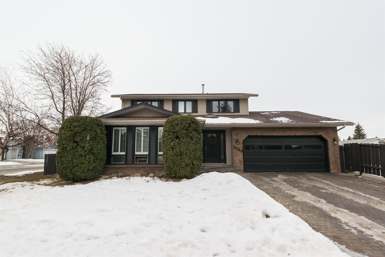 Pride of ownership is evident in this beautiful 4 bdrm, 3 bath home on Edmonton?s southside. A short distance to the Heritage LRT Station, this gorgeous home is situated perfectly on a large corner lot in the quiet neighbourhood of Steinhauer. The interlocking-brick driveway leads you to the front door & into a large porch area w/ a skylight. Down the hall to the reno?d 2 pc bath & open-concept kit / liv rm space w/ lovely gas f/p. Vaulted ceilings & skylights accent the liv rm which leads out patio doors to the cedar deck. Kit has been completely reno?d! Modern main boasts slate, h/w&carpet floors, & laundry. 2nd deck/garden on southside. Formal din rm & sunken liv rm are carpeted & contemporary. Upstairs, 4 bdrms + 2 full bath (1 main, 1 ensuite) w/ tile floors, tile & cultured-marble surround. Fin. bsmt w/ large rec rm, 2 dens & furnace rm. Professionally landscaped yard, cedar deck & bridge, shrubs, trees & vines. Dbl-att garage, NEW shingles (?98), NEW H20 tank (?15), NEW windows & custom shutters!