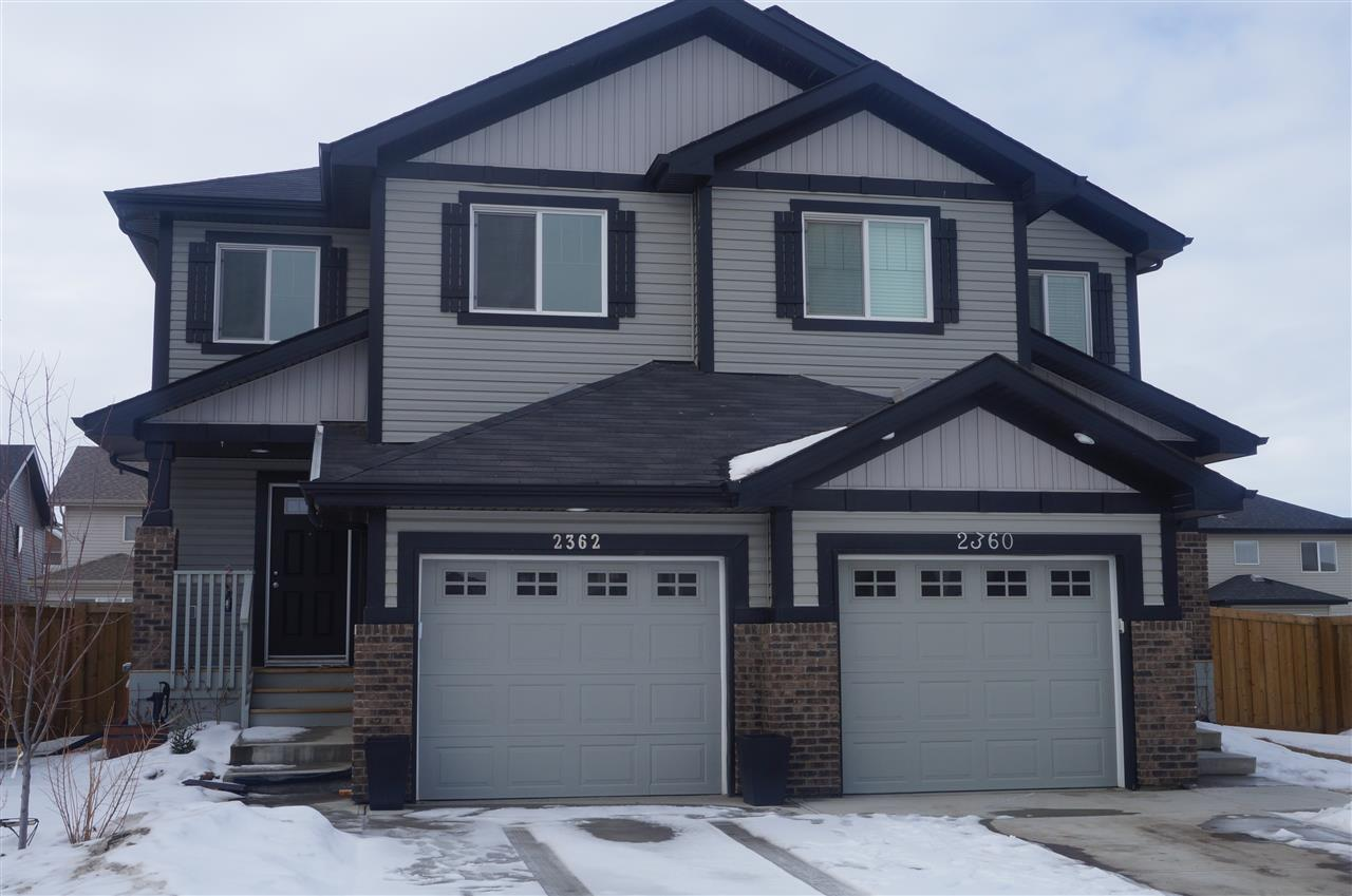 "Situated on a larger lot, this 2-storey half duplex was built in 2013.  The home features an open concept living area. This level has a kitchen with high end Samsung appliances, walk through pantry, coffee bar w/stools, adjacent dinette, living room w/gas fireplace and double garden doors leading to a large 12x16 deck w/natural gas .  A large entry and a 2-piece powder room complete this level.  The upper level offers a master suite with 3-piece en-suite and WI closet.  Two additional bedrooms, laundry room, closet and 4-piece bath and a computer nook w/desk complete this level.  The basement is open awaiting your special touch.  Numerous upgrades include, pot lights in the kitchen, garden door, tile back-splash, glass pantry door, entertainment wiring, 2 closets by the front entry, stair railing, crown molding above doors, extra outlets, 24x10'8"" s/car attached garage is  dry walled and has 2 hose bibs. The yard is fenced and landscaped. Quick possession available.  Easy access to H-way 2 and A.Henday."