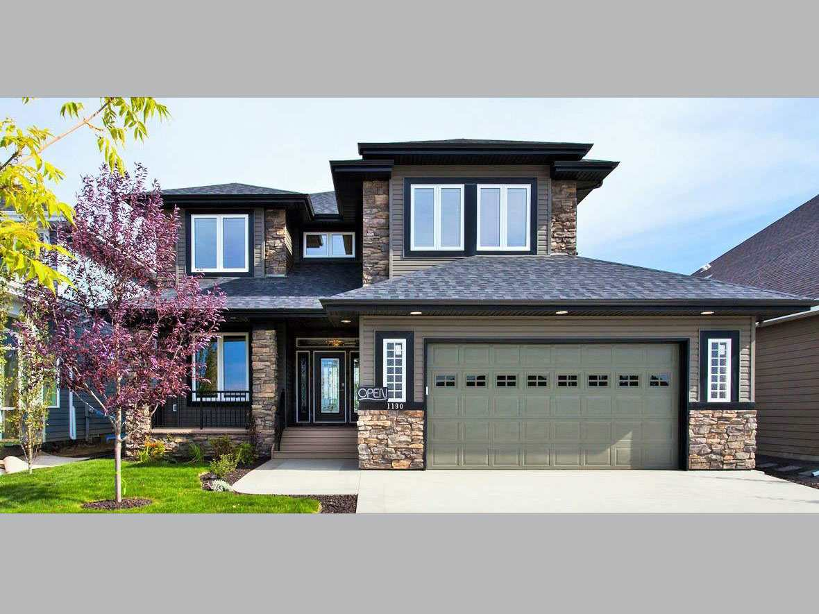 """FORMER SHOWHOME!! BRAND NEW!!! 2400 sq ft 2 story by """"Caribbean Homes"""". Fully & beautifully landscaped, front verandah, bright rear deck! Completely upgraded home featuring hardwood, ceramics, granite and stainless appliances, 9ft ceilings, air conditioning, large triple pane windows, 2x6 construction, closet organizers, ensuite with full tile shower & double shower head, huge walk in pantry, oversize garage. Gorgeous curb appeal, quite large lot backing onto trail. This home is complete and ready to move in. THIS FORMER SHOWHOME IS PRICED TO SELL! Genesis on the lakes is a new Stony Plain subdivision featuring walking trails, huge park, large building lots and great neighbours! Walking distance to shopping centre, quick drive to hwy & town centre."""
