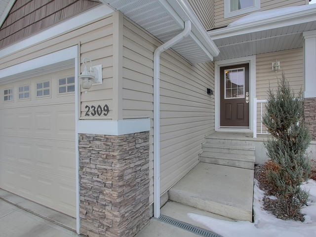 Why rent when you can own for less. This 1/2 duplex has an EnerGuide rating of 83. Most new homes are less than 80. This home features an ample amount of espresso coloured cabinets, Granite countertops, Harwood Floors, Great room Concept, High efficient furnace, Tank less hot water system, Attached garage with direct access into the home, 3 generous bedrooms upstairs with the Master having a 3 pc. ensuite and his and hers closets, a partially finished rec. room in the basement with an additional washroom roughed in. South facing fenced back yard features a nice sized deck with natural gas BBQ outlet. This home is conveniently located 1 block from park, close to transit and is only about 20-25 min by bus to U of A or Downtown. 5 min access to Anthony Henday and 15 min to the Airport or Nisku. This home defiantly needs to be on your list of affordable homes to see!!!