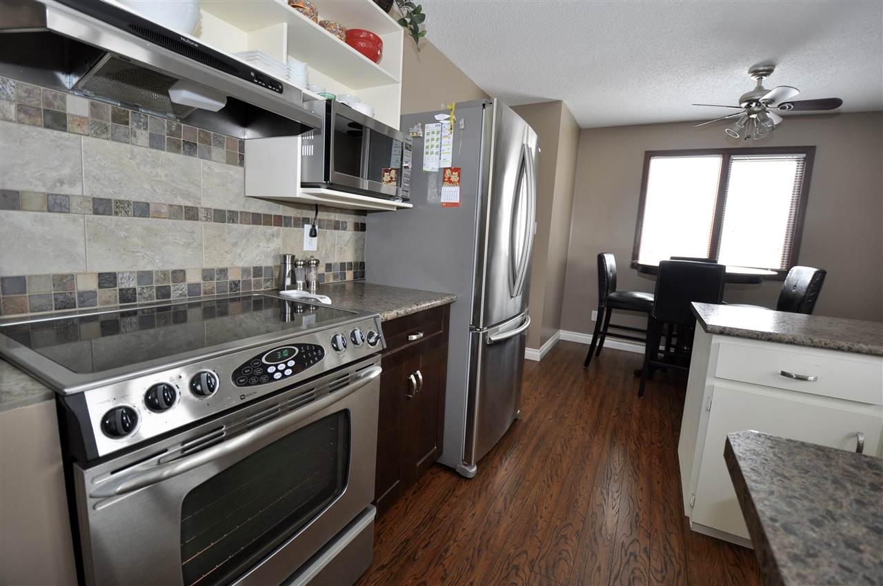 HALF A BLOCK TO WHISPERING WATERS PARK * IT'S EXTENSIVE TRAIL SYSTEMS!!! TONS OF UPGRADES ..... FABULOUS PRICE .... and a FULLY FINSIHED & BEAUTIFULLY DEVELOPED BSMNT w/ an OPTION FOR A PRIVATE SUITE ENTRANCE !!! NEW FLOORING (Main Flr) !!! LIGHT BRIGHT KITCHEN W/ plenty of upgrades and S/S APPLIANCES. FABULOUS LOCATION !!! K - 9 STUDENTS WALK 1/2 BLOCK TO ENGLISH/FRENCH IMMERSION SCHOOL. JUST ACROSS THE STREET.... They simply walk out the door, cross the street & they are on the corner of the school grounds. THIS SQUEAKY CLEAN HOME FEATURES: UPGRDED LIGHT BRIGHT KITCHEN; CUDDLE IN THE SPACIOUS L.R.; UPGRADED 4 PCE BATH. BSMNT DEVEL INCLUDES: MASSIVE FAMILY/GAMES ROOM; DEN; BATHRM; STORAGE RM; LAUNDRY ROOM. ALL ON SOUTH FACING, BEAUTIFULLY LANDSCAPED FENCED LOT.