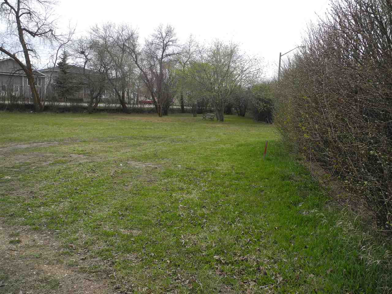 SELLER IS MOTIVATED!! One title, two lots.... HUGE 15,373 SQUARE FOOT LOT....Park like setting in the heart of Westlock. Currently zoned low density but with a lot of this size perhaps multi-family is possible?? Partially fenced with chain link and lined with hedges and trees. Drive thru access, truly one of a kind property with all sorts of possibilities.