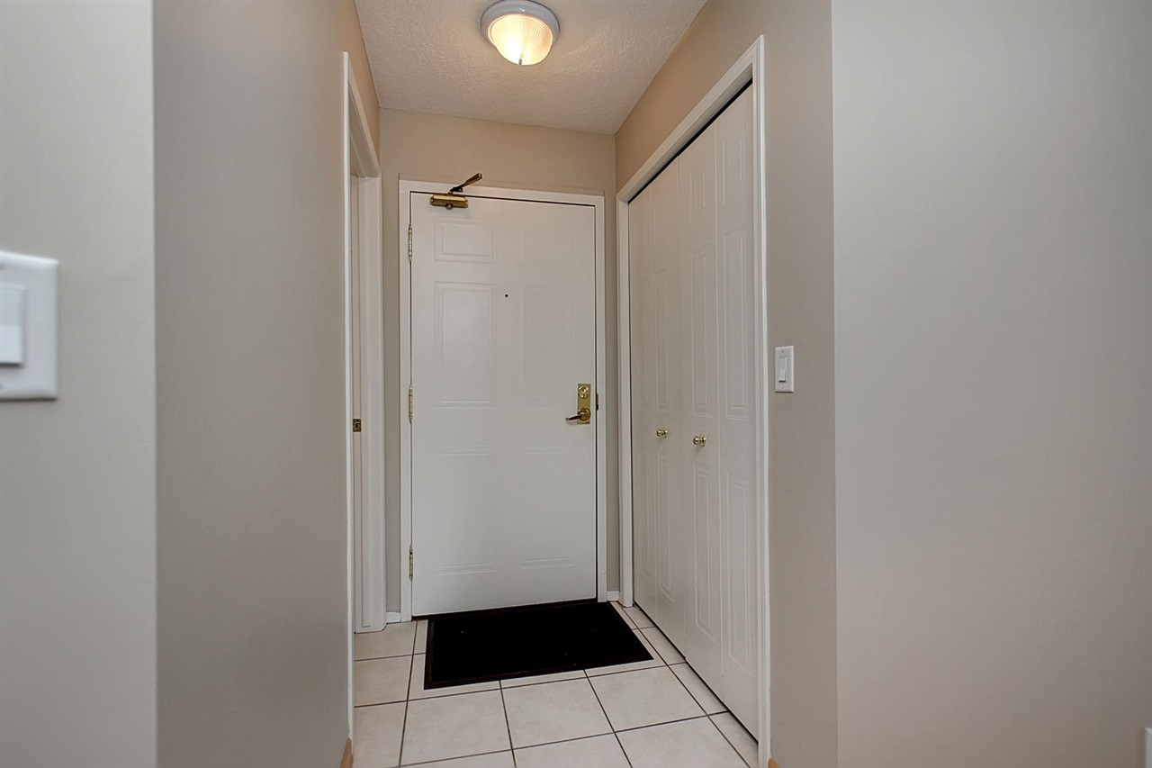 Inside your PENTHOUSE unit, there is an entry with ceramic tile flooring, a very deep closet and across from it, the handy powder room.
