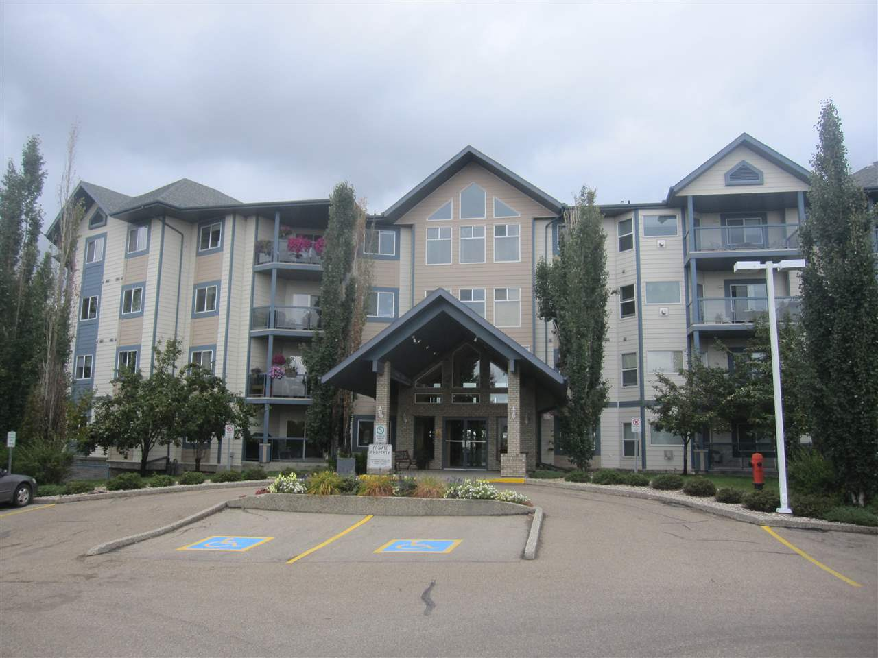 Prime top floor unit with nice view of the lake and easy access to Foxhaven Wetlands and Heritage Trail System. Unique location with no neighbors above and on one side only. Nice open plan with upgraded maple kitchen with easy close hardware, beautiful quartz countertops and quality floor covering. Spacious living room hilited with a cozy gas fireplace(circulating fan) and high end berber carpet. big master has walk-thru closet and 3 pce. ensuite. Good size second bedroom. Full bathroom with soaker tub. Insuite laundry with good storage space. TWO TITLED UNDERGROUND HEATED STALLS, ONE WITH STORAGE CAGE. Building is exceptionally  well maintained and managed. Amenities include library/reading room (4th floor), games room with pool table (3rd floor), party room and exercise room (1st floor). This unit shows well and is in move in condition.