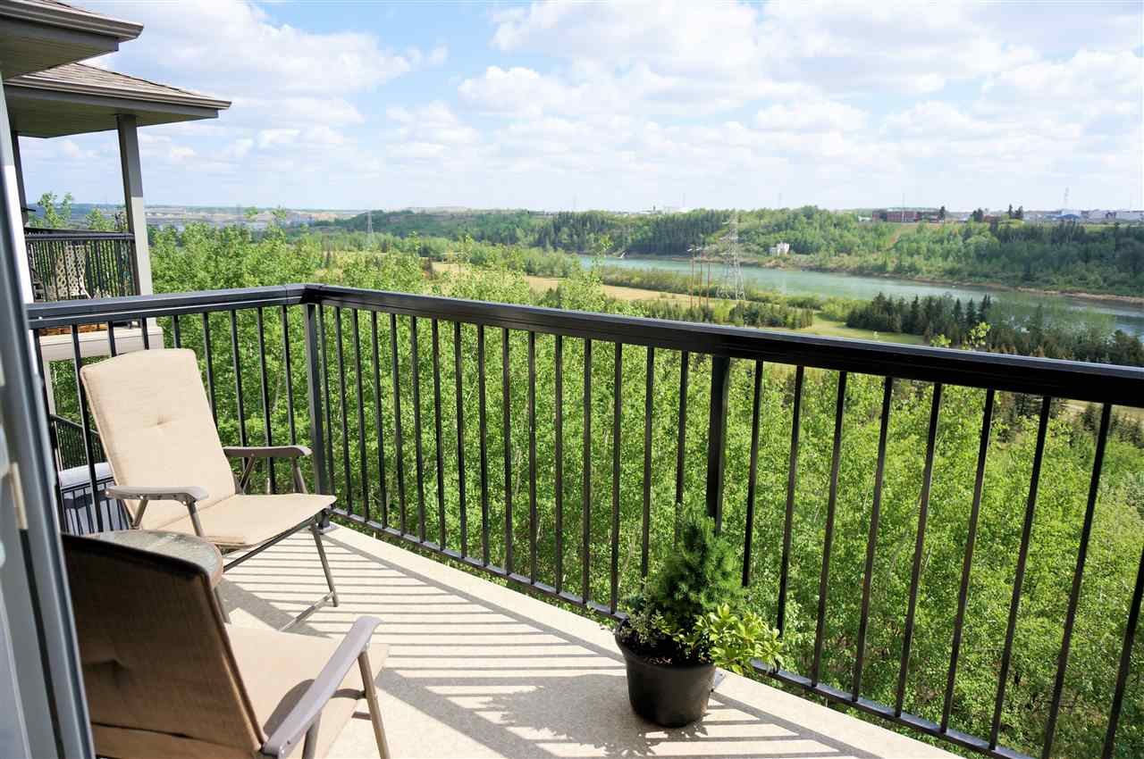 "AWESOME RIVER VALLEY VIEW!  This 2 bedroom and 2 full bath, TOP floor east facing condo in ""The Avenue At Hermitage"" is ready for you to enjoy! Features include: 896 sq,ft. of living space, modern open concept kitchen with stainless steel appliances and breakfast bar, generous dining area, bright and spacious living room, balcony, central elevator, INSUITE laundry, and 2 parking stalls (tandem).  Additionally, master's retreat has a walk-through closet and ensuite bathroom.  Both bedrooms are on opposite ends of unit.  All utilities are included in the condo fees, except power.  Extensive walking/biking trails via Hermitage river Valley and Rundle Park.  Sunridge Ski Area and Rundle Golf Course are nearby.  Quick access to all amenities and major routes.  QUICK POSSESSION!"