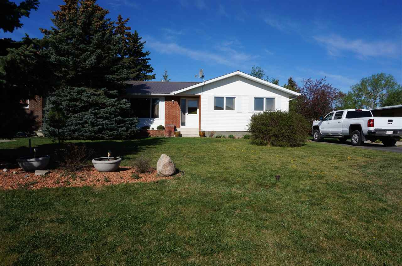 Welcome to your new home in Thorsby.  This 1974 1389sf bungalow has been very well maintained and offers many extras.  The home features a master suite with 3pc bath, 2 additional bedrooms, a very large great room with fireplace, good sized kitchen w/dining area, 4 pc bath and main floor laundry.  The basement features a large family area with wet bar and electric fireplace, den/office, additional kitchen with appliances, 2 pc bath, and plenty of storage.  The exterior is maintenance free with metal roof, vinyl exterior, landscaping with fruit trees, 26x26 insulated and heated garage, 2 sheds and lots of parking including RV parking.  The seller is offering selected furniture items to included in the sale.  This home is an excellent starter home for a growing family.