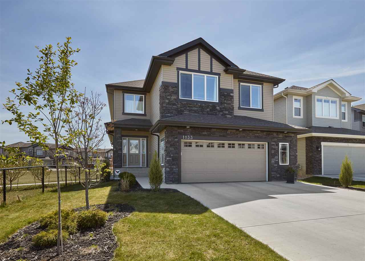 The location you have been looking for, backing onto a park with walking paths leading to a pond! A stunning home built by Bedrock homes feels like new, quality finishings throughout; hardwood, tile & granite counter-tops. This 2-storey home has over 2260sqft of living space plus unfinished basement; 3 beds plus den, 3 baths, loft style bonus room with full views of the park, oversized dble attached garage & fully landscaped 5081sqft lot.Entering the home you are instantly captured by the floor to ceiling south facing windows allowing for natural light to flow throughout the home. Enjoy the spacious kitchen w/large island, granite countertops, upgraded cabinets & ample storage. Open to the kitchen; large dining area & living room w/20 ft ceilings, powder room & mud room w/entrance to the garage complete the main floor! Upstairs is the bonus room, large master bed w/5 piece ensuite, 2 kids beds & upper laundry. Great for every family; close to all amenities, catchment:Bessie Nichols & Sister Anita Brockman
