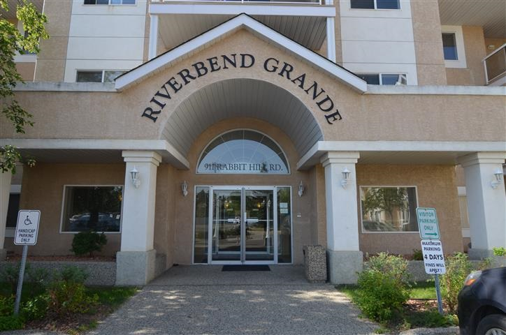 Lovely 2 Bedroom Condo in the well run Riverbend Grande.  Almost 1000 square feet of living space with a large living room and corner gas fireplace. Open to the kitchen area and dining space.  The kitchen is bright with newer appliances (Fridge and Stove 2013).  The unit has brand new carpet in the living room and second bedroom. There is a large storage area which also acts as the laundry area. There is a full 4 piece bathroom close to the second bedroom.  The master bedroom has a walk through closet to their private 3 piece ensuite. The patio has a gas hook-up for a bbq. This unit is close to the elevators, and the building also has a social room, library, and outdoor patio. Unit also has a titled underground parking stall.