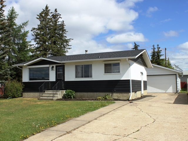 Spacious corner lot (62 ft x 140 ft) close to shopping and recreation grounds in the growing Town of Tofield, just 30 minutes east of Edmonton and Sherwood Park (sun at your back in the am and pm) and only 45 minutes from the Edmonton International Airport (YEG).  2+1 bedroom bungalow (freshly painted).  Partly finished basement.  Electrical upgraded to 100 AMP service.  Fenced yard.  Front drive 24 x 22 detached garage.  Tofield offers a health centre, medical and dental clinics, golf course, numerous other recreational activities and GOOD QUALITY WATER!  Welcome home!