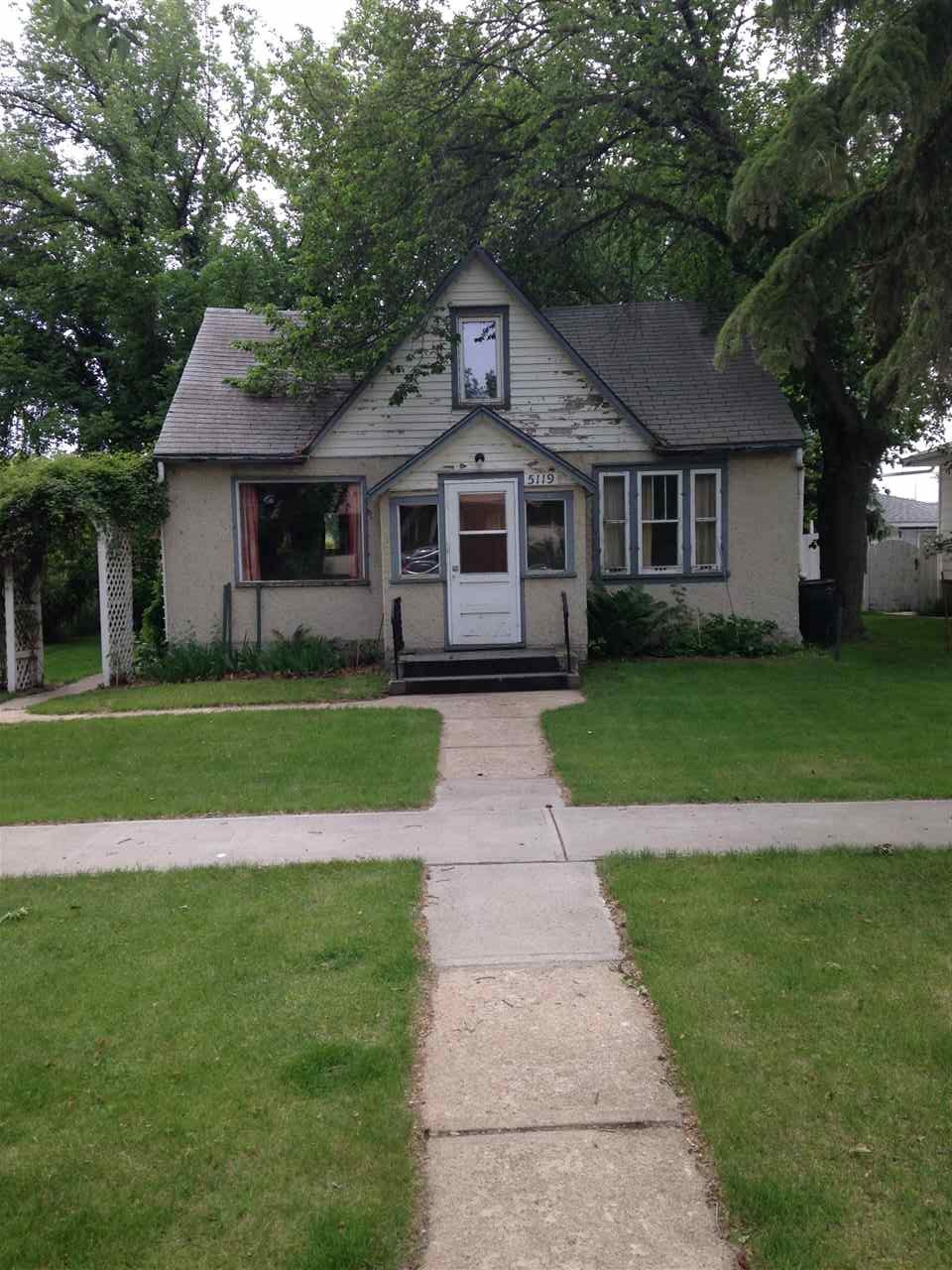 Good potential for the handy person in this 4 bedroom, 1 bath home close to school, shopping and clinic. Addition on basement built in 1972 with some windows upgraded, hot water tank 2007, & newer furnace - approx. 5yrs. Large lot has mature trees, fruit trees and greenhouse. Needs some TLC.