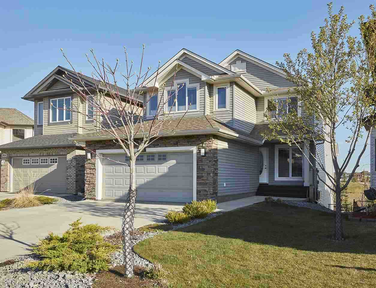 Serenity all year round! Stunning one of a kind views backing onto a pond & located on a quiet cul-de-sac in South Terwillegar. This amazing 2 storey home with over 2240sqft of living space plus an unfinished walkout basement is truly one of a kind. Entering the home you are welcomed by the large foyer with an incredible amount of natural light from the large windows. To your right is the den/home office, continue on into the living room with gas fireplace that is open to the kitchen with large island, dining nook & incredible views of the fully landscaped back yard overlooking the pond. Floor to ceiling windows allow for ample natural light, you can enjoy the views from the living room & kitchen! Step out side on to the large deck perfect for summer bbq's. A half bath & laundry room complete the main floor. Upstairs you will find a large bonus room for family movie nights, the hotel feel master bdrm with 5 piece ensuite & 2 add'l bdrms are a great size that complete the 2nd level.The perfect location!